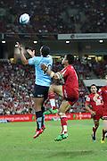 Kurtley Beale out jumps Digby Ioane. Queensland Reds v NSW Waratahs. Investec Super Rugby Round 10 Match, 24 April 2011. Suncorp Stadium, Brisbane, Australia. Reds won 19-15. Photo: Clay Cross / photosport.co.nz