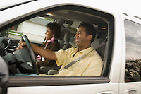 Couple in car man driving side view