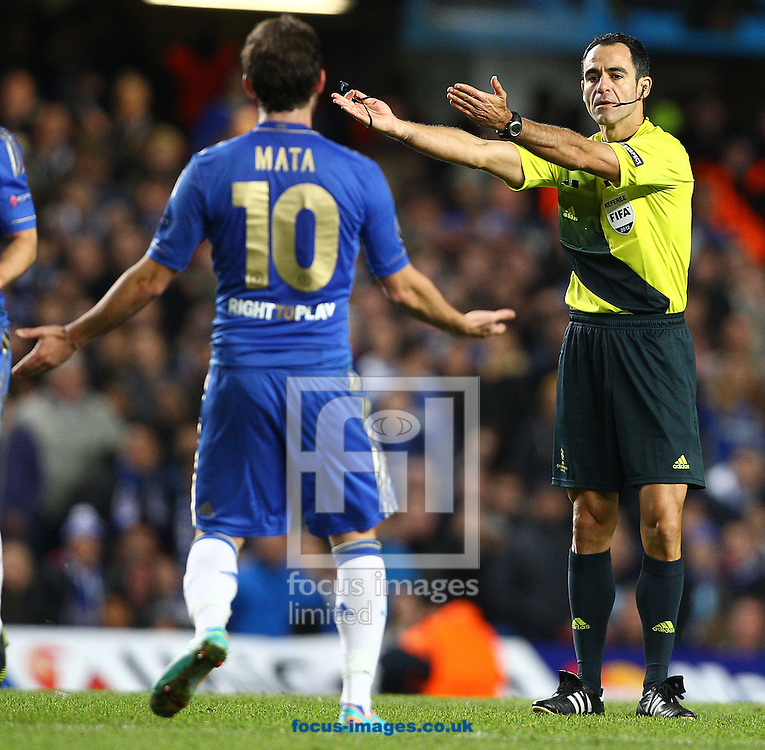 Picture by Paul Terry/Focus Images Ltd +44 7545 642257.07/11/2012.Juan Mata of Chelsea disagrees with a decision from referee Carlos Velasco Carballo during the UEFA Champions League match at Stamford Bridge, London.