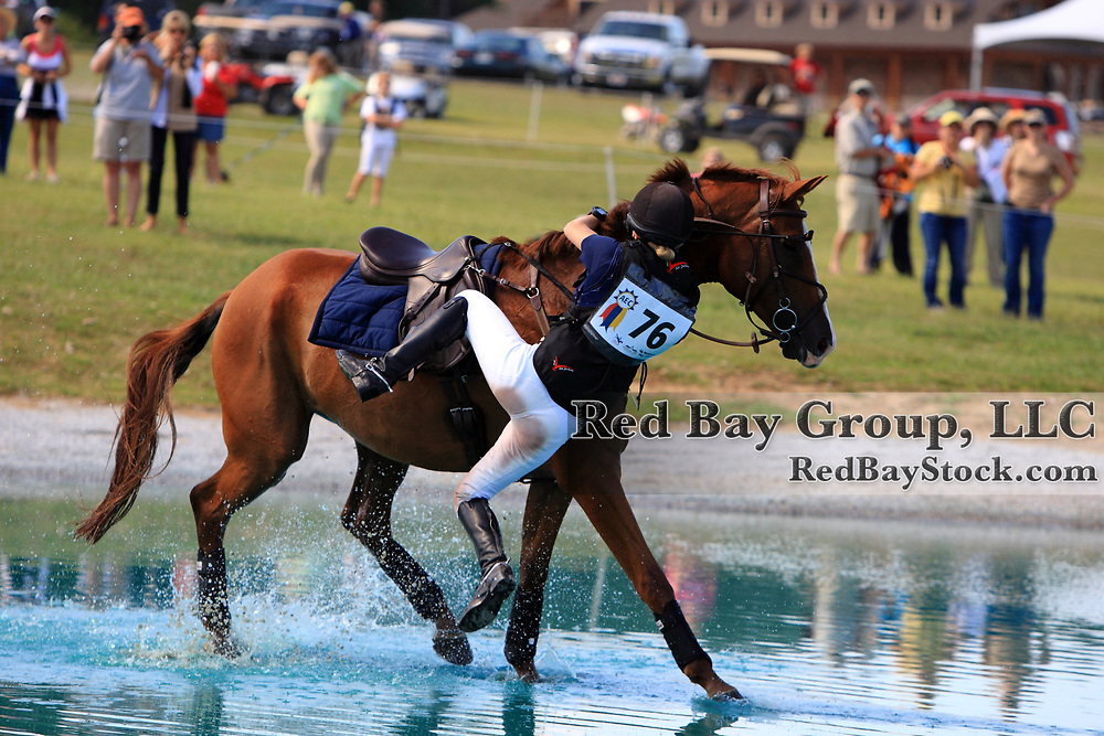 Mary Atkins Hunt riding Nuance have a fall at the water during the 2011 American Eventing Championships in Fairburn, Georgia.