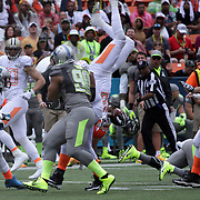 Cleveland Brown's Wide Receiver, Josh Brown, gets flipped by his own teamage, Strong Safety TJ Ward, during the NFL Pro Bowl, Aloha Stadium, Honolulu, Hawaii.  1/26/14, Photo by Abe Markowitz, Courtesy STP/TriMarine
