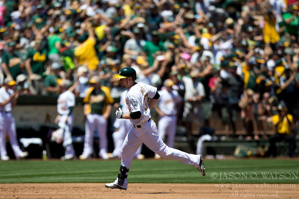 OAKLAND, CA - MAY 26:  Brandon Moss #37 of the Oakland Athletics rounds the bases after hitting a home run off of Drew Smyly #33 of the Detroit Tigers (not pictured) during the second inning at O.co Coliseum on May 26, 2014 in Oakland, California. The Oakland Athletics defeated the Detroit Tigers 10-0.  (Photo by Jason O. Watson/Getty Images) *** Local Caption *** Brandon Moss