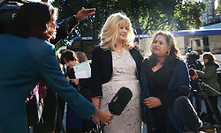 © Licensed to London News Pictures. 14/10/2015. London, UK.  Alison Sharland (L) and Varsha Gohil talk to reporters outside the Supreme Court. A ruling has stated that they are entitled to more money in their divorce settlements after their husbands hid the true state of their wealth.  Photo credit: Peter Macdiarmid/LNP