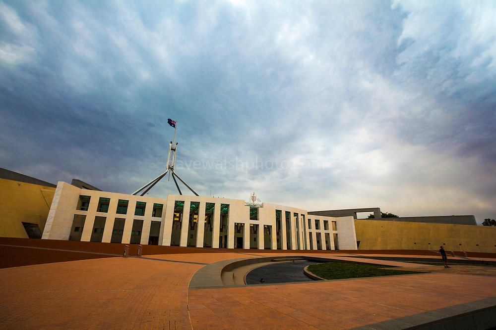 Parliament House, Canberra, Australia. The building was designed by Mitchell - Giurgola & Thorp Architects and built by a Concrete Constructions and John Holland joint venture. It was opened on 9 May 1988 by Elizabeth II, Queen of Australia.