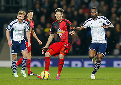Federico Fernandez of Swansea City is challenged by Brown Ideye of West Brom - Photo mandatory by-line: Rogan Thomson/JMP - 07966 386802 - 11/02/2015 - SPORT - FOOTBALL - West Bromwich, England - The Hawthorns - West Bromwich Albion v Swansea City - Barclays Premier League.