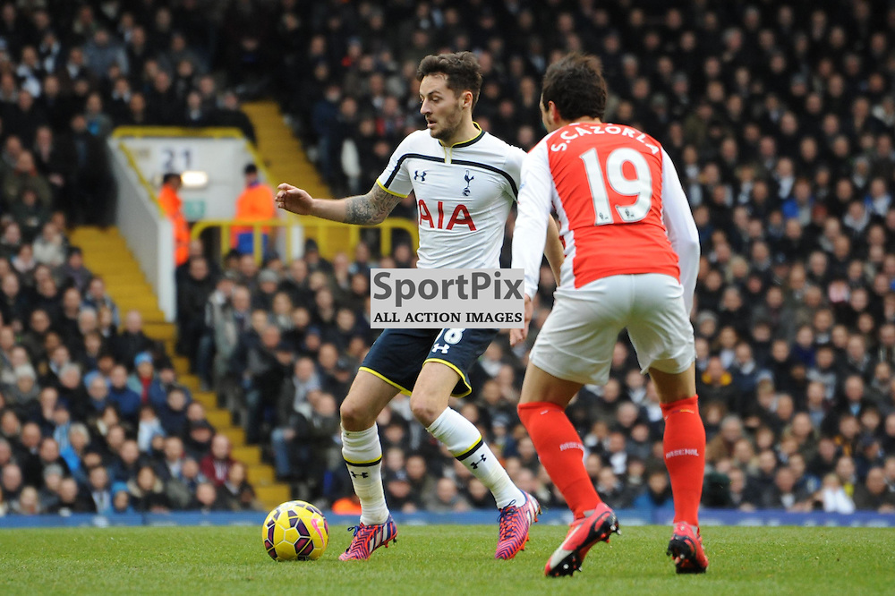 Tottenhams Ryan Mason and Arsenals Santi Cazorla in action