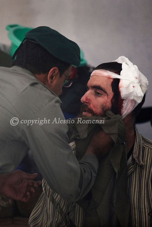 An Israeli border policeman attends a wounded Israeli settler injured in the east Jerusalem neighborhood of Sheikh Jarrah, Tuesday, Dec. 1, 2009 during scuffles with a Palestinian family and local activists over a disputed house.. In an unrest Tuesday, a Jewish family took over a house in an Arab neighborhood of east Jerusalem, sparking a protest by rock-throwing Palestinians and a few Israeli and foreign activists who joined them, police said. One of the family members was lightly injured in the head when a protester hit him with a metal bar, and police arrested five people. Both sides claim ownership of the building. ..© ALESSIO ROMENZI