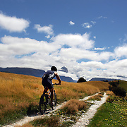 A competitor in action during the Cycle leg of the Paradise Triathlon and Duathlon series with breathtaking views of Mount Aspiring National Park, Paradise, Glenorchy, South Island, New Zealand. 18th February 2012. Photo Tim Clayton
