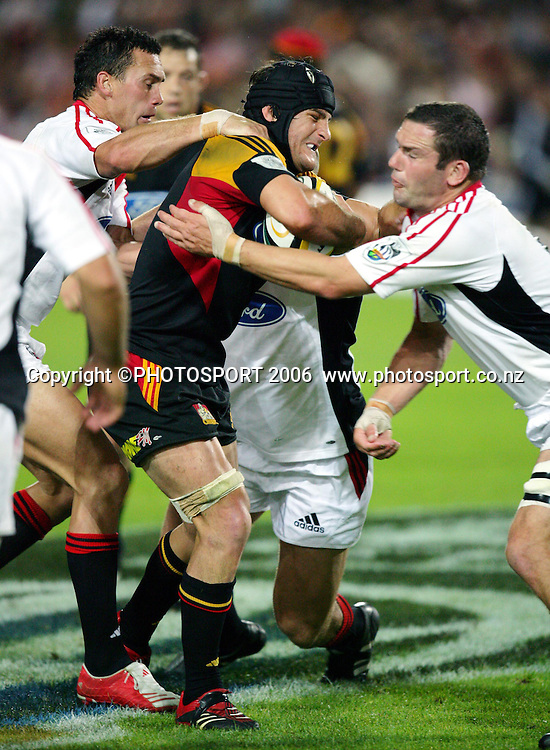 Chiefs Marty Holah is grabbed by Caleb Ralph, left, and Reuben Thorne during the Super 14 rugby union match between the Chiefs and the Crusaders, won by the Crusaders 25-19  at Waikato Stadium, Hamilton on Friday 10 March 2006. Photo: Stephen Barker/PHOTOSPORT