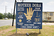 Sign damaged by Hurricane Katrina in New Orleans East.
