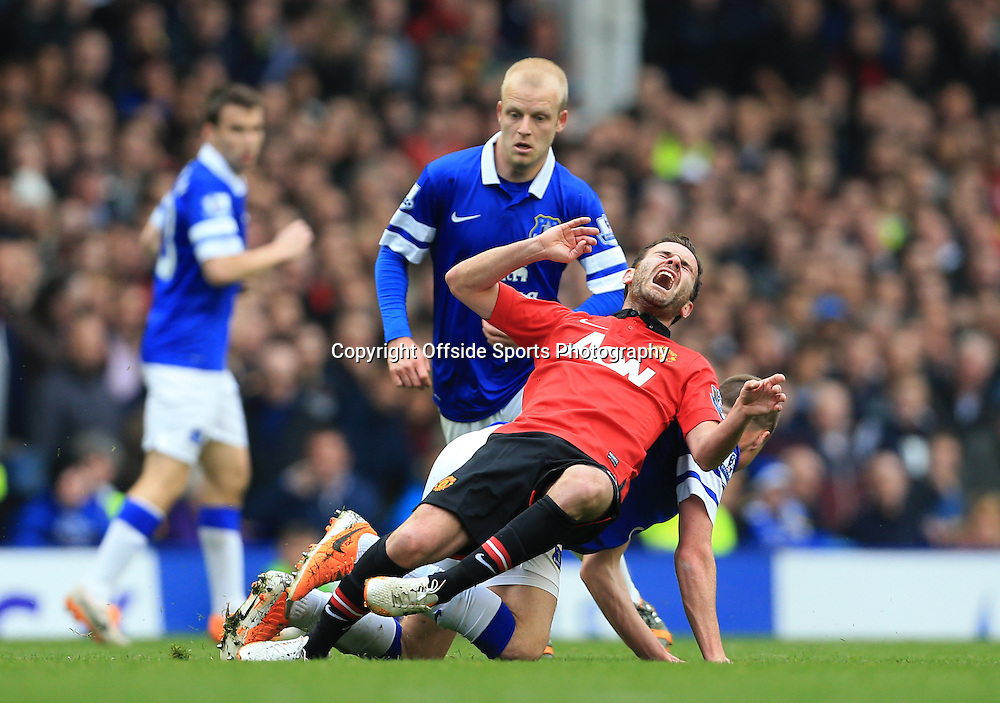 20th April 2014 - Barclays Premier League - Everton v Manchester United - Juan Mata of Man Utd screams in agony - Photo: Simon Stacpoole / Offside.