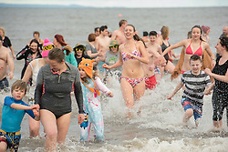 Hundreds braved the freezing sea in Portobello this lunchtime for the traditional 'Loony douk'.<br /> <br /> <br /> © Jon Davey/ EEm