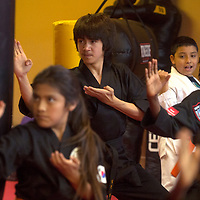 Dylan Vargas leads his karate class through a routine Monday in Gallup.