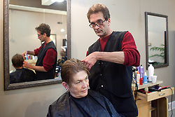 Vicco Mayor Johnny Cummings, right, styles Sally Kemerer's hair, Wednesday, Jan. 16, 2013 at Scissors Salon in Vicco.