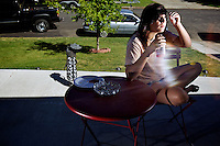 Makayla Franks sitting on the  front porch at her Post Falls, Idaho home on Friday, Aug. 19, 2011 while I test my lights.