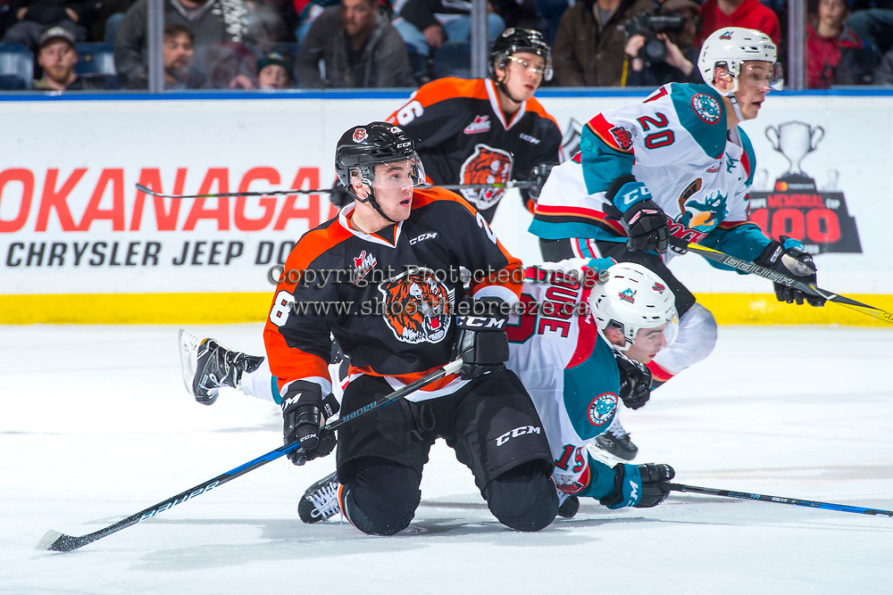 KELOWNA, CANADA - JANUARY 30: Bryan Lockner #28 of the Medicine Hat Tigers collides with Dillon Dube #19 of the Kelowna Rockets on January 30, 2017 at Prospera Place in Kelowna, British Columbia, Canada.  (Photo by Marissa Baecker/Shoot the Breeze)  *** Local Caption ***
