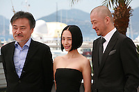 Director Kiyoshi Kurosawa, actress Eri Fukatsu and actor Tadanobu Asano at the Journey To The Shore film photo call at the 68th Cannes Film Festival Sunday May 17th 2015, Cannes, France.