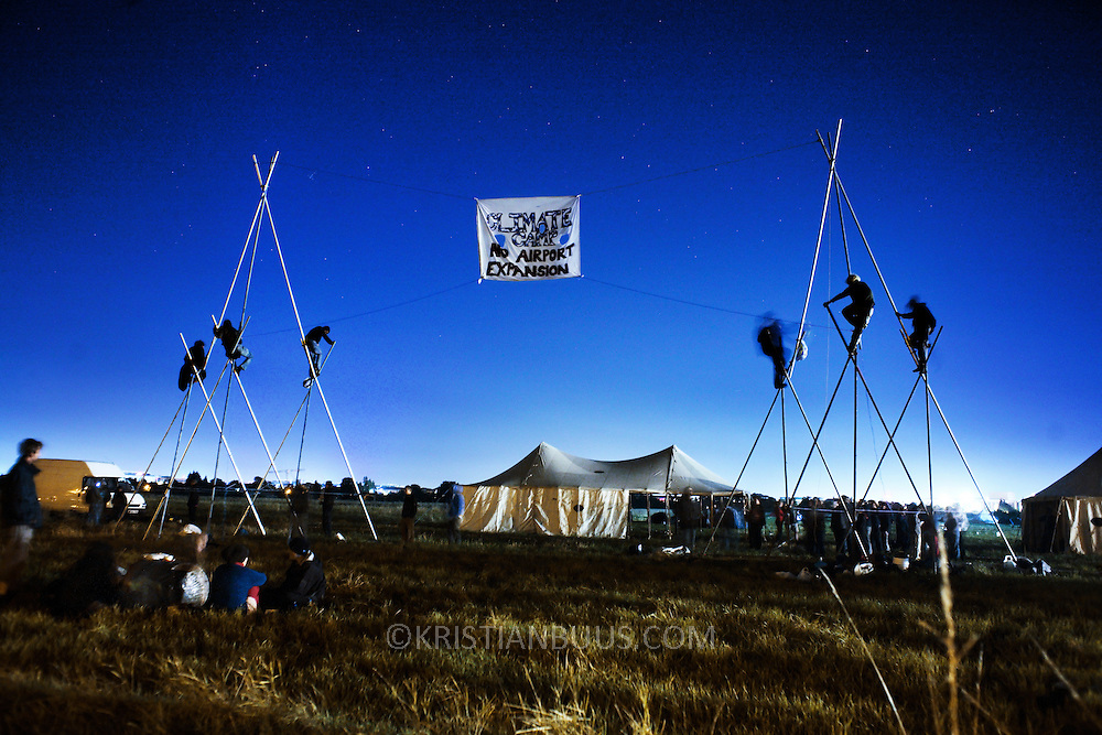 The Camp for Climate Change UK 2007<br /> The camp was a camp set up to highlight protests against a proposed third runway at Heathrow, destroying nearby villages and to put the spotlight on climate change issues. The camp was set up during the night and in place with tents and infrastructure on a field near HEathrow before the authorities could act.