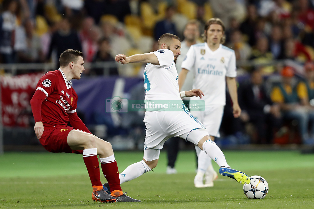 (L-R) Andy Robertson of Liverpool FC, Karim Benzema of Real Madrid during the UEFA Champions League final between Real Madrid and Liverpool on May 26, 2018 at NSC Olimpiyskiy Stadium in Kyiv, Ukraine
