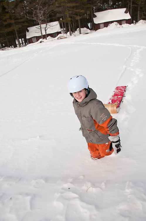 Sledding at the Keweenaw Mountain Lodge in Copper Harbor Michigan in winter.