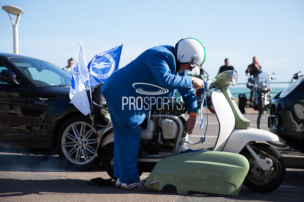 Mod scooterist breaks down during the Brighton & Hove Albion Football Club Promotion Parade at Brighton Seafront, Brighton, East Sussex. United Kingdom on 14 May 2017. Photo by Ellie Hoad.