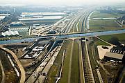 Nederland, Zuid-Holland, Noord-Holland, 11-02-2008; Ringvaart Haarlemmermeer, Huigsloterdijk: aanleg nieuw aquaduct voor de te verbreden Rijksweg A4; dit nieuwe aqua-duct komt naast de bestaande aquaducten voor HSL (links) en A4 (midden); de infrastructuur bundel gezien in zuidelijke richting; transport, infrastructuur, verkeer en vervoer, mobiliteit, hogesnelheidslijn, spoor, rail, HSL, TGV, planologie ruimtelijke ordening, landschap.  .luchtfoto (toeslag); aerial photo (additional fee required); .foto Siebe Swart / photo Siebe Swart