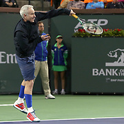 March 1, 2014, Indian Wells, California: <br /> John McEnroe hits the ceremonial first serve in the newly constructed Stadium 2 at the Indian Wells Tennis Garden before the McEnroe Challenge for Charity presented by Esurance.<br /> (Photo by Billie Weiss/BNP Paribas Open)