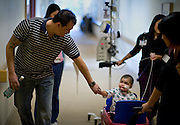 Jeffers holds his daughters hand on the way back to her room at the Stanford Children's Hospital. Friday, February 11, 2011.