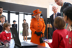 "Queen Elizabeth II speaks with children about computer programming during a visit to the Science Museum for the announcement of their summer exhibition ""Top Secret"" in Kensington, London."