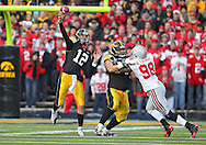 November 20 2010: Iowa Hawkeyes quarterback Ricky Stanzi (12) throws the ball during the first quarter of the NCAA football game between the Ohio State Buckeyes and the Iowa Hawkeyes at Kinnick Stadium in Iowa City, Iowa on Saturday November 20, 2010. Ohio State defeated Iowa 20-17.