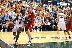 20 March 2010: Philana Greene takes the baseline but is forced to pass by Zoe Unruh. The Flying Dutch of Hope College fall to the Bears of Washington University 65-59 in the Championship Game of the Division 3 Women's NCAA Basketball Championship the at the Shirk Center at Illinois Wesleyan in Bloomington Illinois.