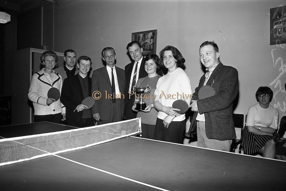 28/4/1966<br /> 4/28/1966<br /> 28 April 1966<br /> <br /> Mr. B. Schoulund Managing Director Leo Laboratories and Mr. Wesley Sullivan Secretary of the Business Houses, Table Tennis League Photographed with the Leo Laboratories Team, Winners of the Business Houses Table Tennis League Division T and Junior Cup at the Championships held at W.D.O.H.O. Wills on South Circular Rd.<br /> <br /> Included are Mrs. T Jameson; Mr. Eamon Whelan, Mr. Tony Dunne, Miss Maire Mcalister, Miss Barbara Byrne, and Mr. Pat McGrave