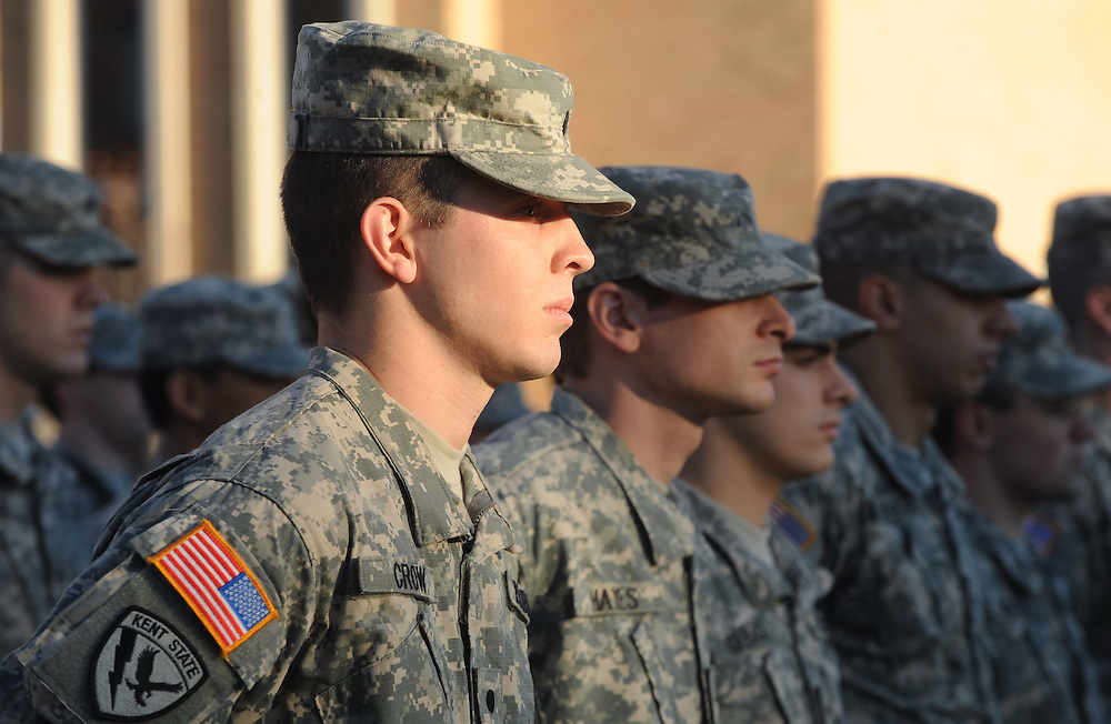 Members of Kent State University's Army ROTC Corps stand at attention during the university's observance of Veteran's Day.