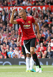 Manchester United's Nemanja Vidic celebrates scoring his side's first goal of the game during Michael Carrick's Testimonial match at Old Trafford, Manchester.
