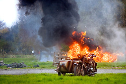 Pyrotechnics explode behind a German Motorcycle and side-car during a battle reenactmant at Pickering 1940s war weekend 16th-18th October 2009 Image Copyright Paul David Drabble