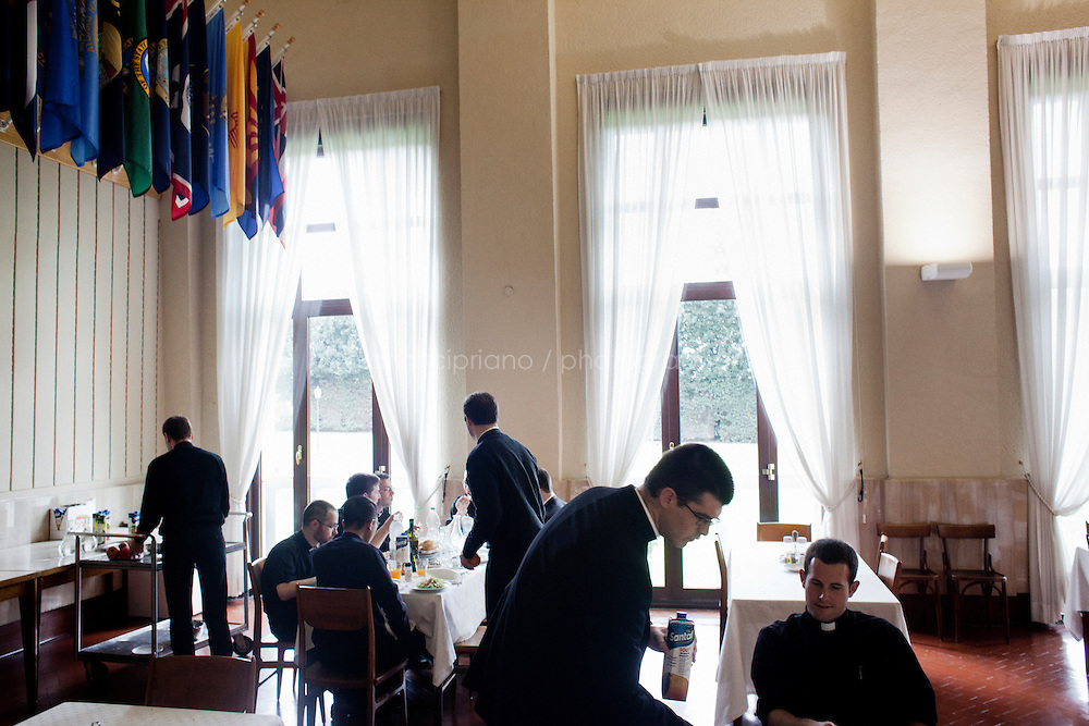 ROME, ITALY - 11 MARCH 2013: Seminarians have lunch at the refectory of the Pontifical North American College  in Rome, Italy, on March 11, 2013. ..The Pontifical North American College is a Roman Catholic educational institution that forms seminarians for priestly ministry in the dioceses in the United States and that provides a residence for American priests pursuing graduate studies...Gianni Cipriano for The New York Times