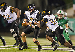 Oct 9, 2015; Huntington, WV, USA; Southern Miss Golden Eagles quarterback Nick Mullens hands the ball off to running back Jalen Richard during the second quarter against the Marshall Thundering Herd at Joan C. Edwards Stadium. Mandatory Credit: Ben Queen-USA TODAY Sports