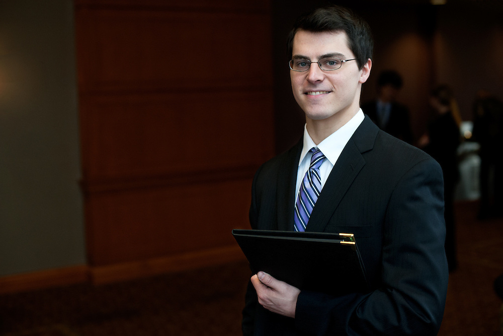 Joe Tiemeier poses for a portrait outside the entrance to the Spring Career and Internship Fair. Photo by: Ross Brinkerhoff.