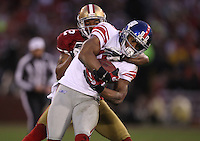 Hakeem Nicks #88 of the New York Giants catches a pass against  Carlos Rogers #22 of the San Francisco 49ers during the NFC championship game at Candlestick Park in San Francisco, California, USA 22 Jan 2012..The Giants defeated the 49ers 20-17. (Photo by Jed Jacobsohn)...