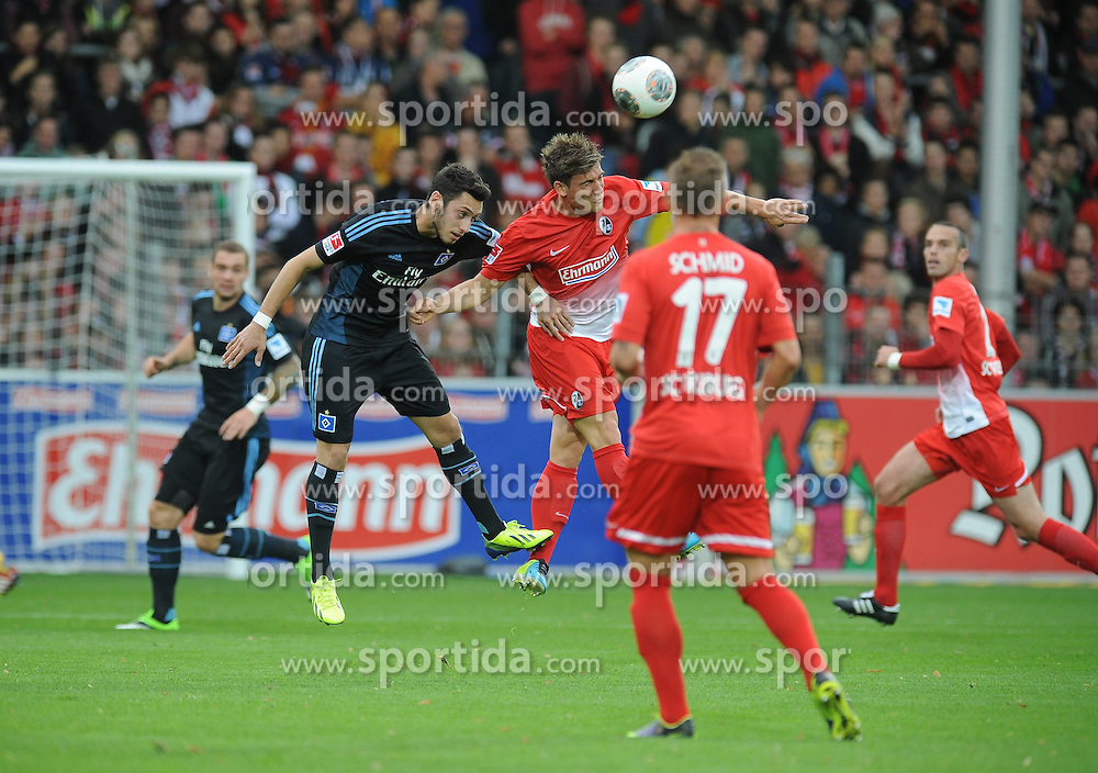 27.10.2013, Mage Solar Stadion, Freiburg, GER, 1. FBL, SC Freiburg vs Hamburger SV, 10. Runde, im Bild Kopfballduell, Aktion zwischen (l ) Hakan Calhanoglu (Hamburger SV) (r ) Oliver Sorg (SC Freiburg) // during the German Bundesliga 10th round match between SC Freiburg and Hamburger SV at the Mage Solar Stadion in Freiburg, Germany on 2013/10/27. EXPA Pictures &copy; 2013, PhotoCredit: EXPA/ Eibner-Pressefoto/ Laegler<br /> <br /> *****ATTENTION - OUT of GER*****