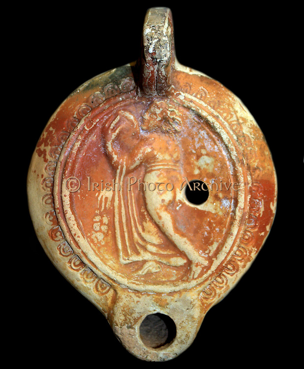 Terracotta lamp with a maenad playing a tambourine. Roman, made at Benghazi, Libya
