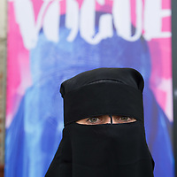 "VENICE, ITALY - JUNE 01:  A model poses in front of Flavio Lucchini's work ""poster/vogue"" part of the exhibition ""What Women Want (?)"" on June 1, 2011 in Venice, Italy. The exhibition addresses the controversiat theme of the burqa"
