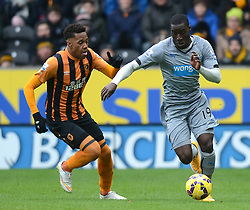 Hull City's Abel Hernandez competes with Newcastle United's Massadio Haidara - Photo mandatory by-line: Richard Martin-Roberts/JMP - Mobile: 07966 386802 - 31/01/2015 - SPORT - Football - Hull - KC Stadium - Hull City v Newcastle United - Barclays Premier League