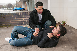 Asian male victim after being attacked with a knife