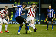 Sheffield Wednesday forward Fernando Forestieri (45) and Sheffield United defender Jack O'Connell (5)  contest a loose ball  during the EFL Sky Bet Championship match between Sheffield Wednesday and Sheffield United at Hillsborough, Sheffield, England on 4 March 2019.