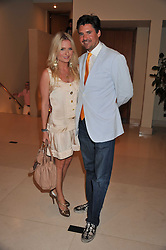 EDWARD TAYLOR and CHARITY FINNIGAN at the Veuve Clicquot Mint Polo in The Park after party held at The Hurlingham Club, Ranelagh Gardens, London SW6 on 5th June 2011.