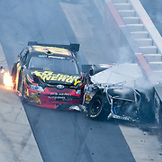 Ryan Truex #99 car on fire after crashing into Clint Bowyer #33 during the final lap of NASCAR Nationwide Series at Dover International Speedway in Dover Delaware...Carl Edwards went on to win the NASCAR Nationwide Series at Dover International Speedway in Dover Delaware..