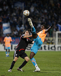 MARSEILLE, FRANCE - Tuesday, December 11, 2007: Liverpool's Yossi Benayoun and Olympique de Marseille's Taye Taiwo during the final UEFA Champions League Group A match at the Stade Velodrome. (Photo by David Rawcliffe/Propaganda)