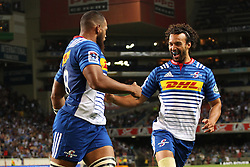Nizaam Carr of the DHL Stormers celebrates his try with Dillyn Leyds of the DHL Stormers during the Super Rugby match between the DHL Stormers and the Vodacom Blue Bulls at Newlands Stadium in Cape Town on the 25th February 2017