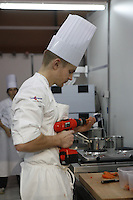 Jasper KURE - NOrway  -at the Bocuse d'Or - drilling holes in  carrots..Owen Franken for the NY Times..January 28, 2009.